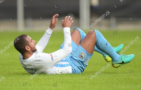 Marcus Tudgay of Coventry City sits on thr ground after being tackled during the EFL Cup First Round match between Coventry City and  Portsmouth played at the Ricoh Arena, Coventry on 9th August 2016