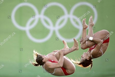 Stock Photo of Mexico's Paola Espinosa and Alejandra Orozco warm up ahead of the women's synchronized 10-meter platform diving final in the Maria Lenk Aquatic Center at the SIXTEEN Summer Olympics in Rio de Janeiro, Brazil, Tuesday, Aug. 9, 2016.