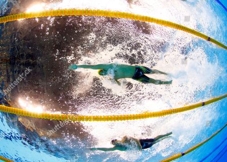 Australia's Cameron Mcevoy, top, and Italy's Luca Dotto compete in a heat of the men's 100-meter freestyle during the swimming competitions at the 2016 Summer Olympics in Rio de Janeiro, Brazil