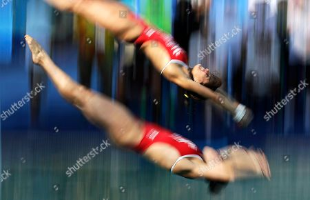 Stock Picture of Mexico's Paola Espinosa and Alejandra Orozco warm up ahead of the women's synchronized 10-meter platform diving final in the Maria Lenk Aquatic Center at the 2016 Summer Olympics in Rio de Janeiro, Brazil