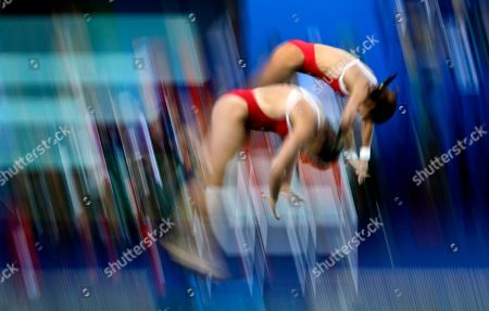 Stock Image of Mexico's Alejandra Orozco and Paola Espinosa compete during the women's synchronized 10-meter platform diving final in the Maria Lenk Aquatic Center at the 2016 Summer Olympics in Rio de Janeiro, Brazil