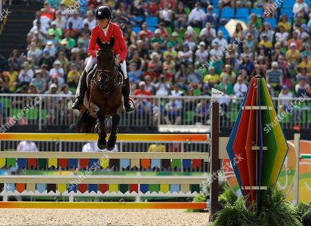 Rebecca Howard, of Canada, riding Riddle Master, competes in the equestrian eventing individual show jumping phase at the 2016 Summer Olympics in Rio de Janeiro, Brazil