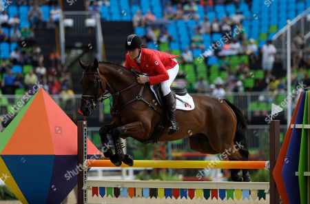 Rebecca Howard, of Canada, riding Riddle Master, competes in the equestrian eventing team show jumping phase at the 2016 Summer Olympics in Rio de Janeiro, Brazil