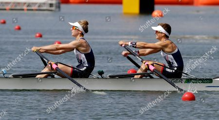Charlotte Taylor and Katherine Copeland, of Britain, compete in the women's rowing pair repechage heat during the 2016 Summer Olympics in Rio de Janeiro, Brazil