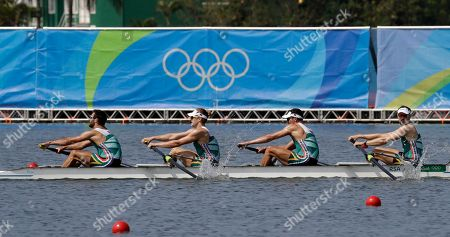 David Hunt, Jonathan Alan Smith, Vincent Breet, and Jake Milton Green, of South Africa, compete in the men's rowing four repechage heat during the 2016 Summer Olympics in Rio de Janeiro, Brazil