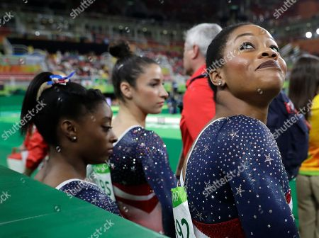 United States' Gabrielle Douglas looks back at the audience before the start of the artistic gymnastics women's team final at the 2016 Summer Olympics in Rio de Janeiro, Brazil