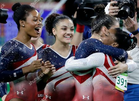 U.S. gymnasts, left to right, Gabrielle Douglas, Lauren Hernandez, Aly Raisman and Simone Biles celebrate at the end of the artistic gymnastics women's team final at the 2016 Summer Olympics in Rio de Janeiro, Brazil