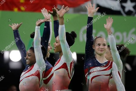 U.S. gymnasts, left to right, Simone Biles, Aly Raisman, Gabrielle Douglas and Madison Kocian wave to the audience at the end of the artistic gymnastics women's team final at the 2016 Summer Olympics in Rio de Janeiro, Brazil
