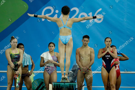 United States' Kassidy Cook, right, waits her turn to dive as she takes part in a training session in the Maria Lenk Aquatic Center at the 2016 Summer Olympics in Rio de Janeiro, Brazil