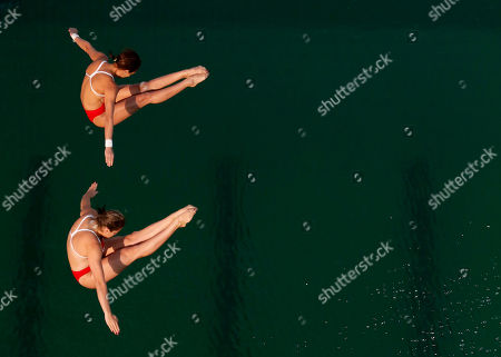 Mexico's Paola Espinosa and Alejandra Orozco compete during the women's synchronized 10-meter platform diving final in the Maria Lenk Aquatic Center at the 2016 Summer Olympics in Rio de Janeiro, Brazil