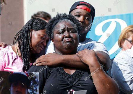 Stock Picture of Matrice Stanley, Dwayne Hill, Antoinette Brown Matrice Stanley, center, sister of Donnell Thompson, who was fatally shot by Los Angeles County Sheriff's deputies in Compton, Calif., her son and Thompson's nephew Joseph Gay, rear, and Thompson's sister Antoinette Brown, left, speak to reporters outside the County Hall of Administration after addressing county supervisors in downtown Los Angeles, . The Sheriff's Department earlier Tuesday had acknowledged that Thompson was not involved with a carjacker who had fired at pursuers when he was shot and killed on July 28, 2016