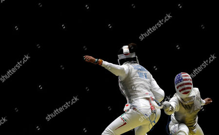 Nzingha Prescod of the United States, right, and Nataly Michel of Mexico compete in the women's individual foil event at the 2016 Summer Olympics in Rio de Janeiro, Brazil