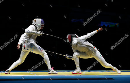 Nzingha Prescod, Nataly Michel Nzingha Prescod from United States, left, and Nataly Michel from Mexico, compete in the women's foil individual fencing event at the 2016 Summer Olympics in Rio de Janeiro, Brazil
