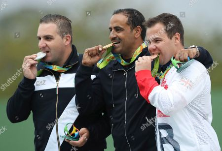 Fehaid Aldeehani, Marco Innocenti, Steven Scott Gold medalist Fehaid Aldeehani, center, an independent athlete from Kuwait competing on the Refugee Olympic Team, is flanked by silver medalist Marco Innocenti, left, of Italy and Steven Scott, right, of Britain during the award ceremony for the men's double trap event at Olympic Shooting Center at the 2016 Summer Olympics in Rio de Janeiro, Brazil