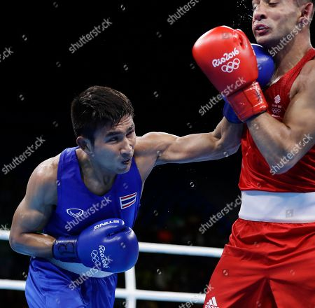 Thailand's Chatchai Butdee, left, fights Britain's Qais Ashfaq during a men's bantamweight 56-kg preliminary boxing match at the 2016 Summer Olympics in Rio de Janeiro, Brazil
