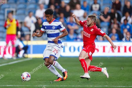Darnell Furlong of QPR and Anton Rodgers of Swindon Town during the EFL Cup First Round match between QPR and Swindon played at Loftus Road Stadium, London on 10th August 2016