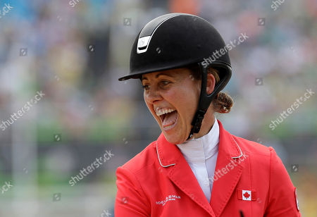 Stock Photo of Rebecca Howard Rebecca Howard, of Canada, reacts after competing in equestrian jumping at the 2016 Summer Olympics in Rio de Janeiro, Brazil