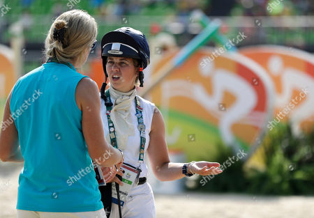 Stock Photo of Kitty King, Tina Cook Kitty King, of Britain, discusses strategy with coach Tina Cook before competing in the equestrian team jumping event at the 2016 Summer Olympics in Rio de Janeiro, Brazil