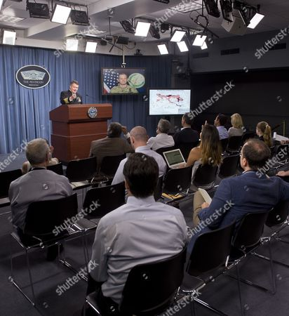 Lieutenant General Sean MacFarland briefs Pentagon correspondents via teleconference as US Navy Captain Jeff Davis moderates from the podium