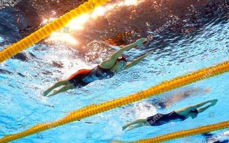 Japan's Kanako Watanabe, left, and Denmark's Rikke Moller Pedersen compete in a heat of the women's 200-meter breaststroke during the swimming competitions at the 2016 Summer Olympics in Rio de Janeiro, Brazil
