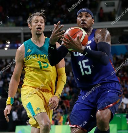 Carmelo Anthony, David Andersen United States' Carmelo Anthony (15) drives past Australia's David Andersen (13) during a basketball game at the 2016 Summer Olympics in Rio de Janeiro, Brazil