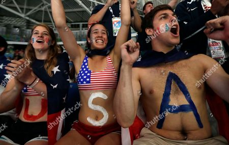 Fans support Nzingha Prescod of the United States as she competes with Astrid Guyart women's individual foil event at the 2016 Summer Olympics in Rio de Janeiro, Brazil