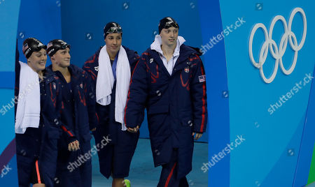 The United States team from left, United States' Allison Schmitt, Leah Smith, Maya Dirado and Katie Ledecky arrive to compete in the final of the women's 4x200-meter freestyle relay during the swimming competitions at the 2016 Summer Olympics, in Rio de Janeiro, Brazil