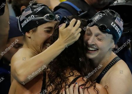 United States' Maya Dirado, left, Allison Schmitt, and Katie Ledecky, right, celebrate winning the gold in the women's 4x200-meter freestyle relay during the swimming competitions at the 2016 Summer Olympics, in Rio de Janeiro, Brazil