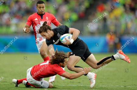 Stock Image of New Zealand's Gillies Kaka, top, is tackled by Britain's Daniel Bibby, during the men's rugby sevens match at the Summer Olympics in Rio de Janeiro, Brazil