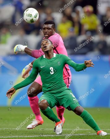 Nigeria's Kingsley Madu (3) and Nigeria goalkeeper Daniel Akpeyi try to control the ball in defense during a group B match of the men's Olympic football tournament between Colombia and Nigeria in Sao Paulo, Brazil