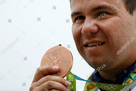 Steven Scott of Britain displays his bronze medal during the victory ceremony for the men's double trap gold match, at the Olympic Shooting Center at the 2016 Summer Olympics in Rio de Janeiro, Brazil
