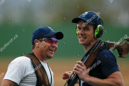 Steven Scott, Tim Kneale Steven Scott of Britain, left, celebrates winning a shootout to secure the bronze medal in the men's double trap bronze medal match as his compatriot Tim Kneale of Britain smiles, at the Olympic Shooting Center at the 2016 Summer Olympics in Rio de Janeiro, Brazil