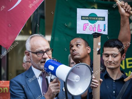 Crispin Blunt MP speaks outside the Department for Transport at a protest for 'fairer fares' oon Southern Rail train services