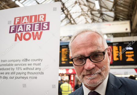 Crispin Blunt MP joins commuters at a protest for 'fairer fares' in Victoria Station