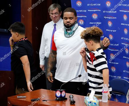 Prince Fielder, Haven Fielder, Jadyn Fielder Texas Rangers' Prince Fielder helps his son Haven, left, and Jaydn, right, away from the podium after a news conference before a baseball game against the Colorado Rockies, in Arlington, Texas. The 32-year-old slugger won't play baseball again, unable to come back after his second neck surgery