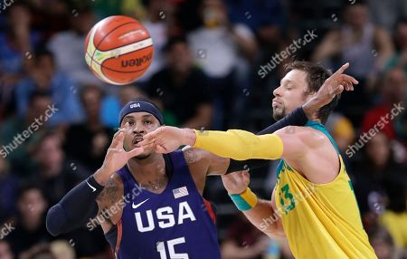 Carmelo Anthony, David Andersen United States' Carmelo Anthony (15) catches a pass over Australia's David Andersen (13) during a basketball game at the 2016 Summer Olympics in Rio de Janeiro, Brazil