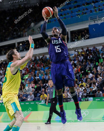 Carmelo Anthony, David Andersen United States' Carmelo Anthony (15) shoots over Australia's David Andersen (13) during a men's basketball game at the 2016 Summer Olympics in Rio de Janeiro, Brazil