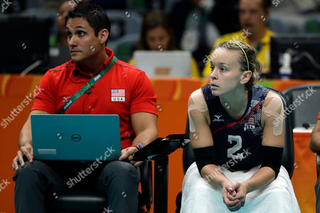 United States' Kayla Banwarth and assistant coach David Hunt view their women's preliminary volleyball match against Serbia at the 2016 Summer Olympics in Rio de Janeiro, Brazil