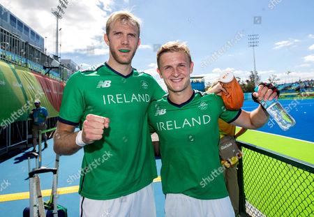 Men's Hockey - Group Stage. Ireland vs Canada. Ireland's Conor Harte and Michael Watt celebrate winning