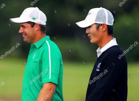 Golf. Ireland's Padraig Harrington with Danny Lee of New Zealand