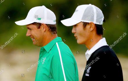 Golf. Ireland's Padraig Harrington and Danny Lee of New Zealand