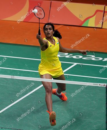 Stock Photo of Sindhu Pusarla India's Sindhu Pusarla returns a shot against Hungary's Laura Sarosi during a women's badminton match at the 2016 Summer Olympics in Rio de Janeiro, Brazil