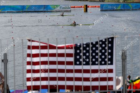Genevra Stone, top, of United States, and Fie Udby Erichsen, of Denmark, competes in the women's single scull heat during the 2016 Summer Olympics in Rio de Janeiro, Brazil