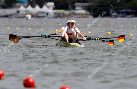 Marie-Catherine Arnold and Mareike Adams, of Germany, compete in the women's rowing double sculls final during the 2016 Summer Olympics in Rio de Janeiro, Brazil