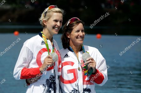 Victoria Thornley and Katherine Grainger, of Britain, hold their medals after winning silver in the women's rowing double sculls final during the 2016 Summer Olympics in Rio de Janeiro, Brazil