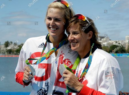 Victoria Thornley and Katherine Grainger, of Britain, pose for photographers after winning silver in the women's rowing double sculls final during the 2016 Summer Olympics in Rio de Janeiro, Brazil