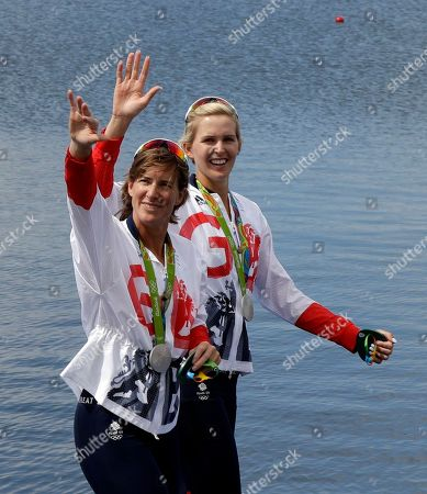 Victoria Thornley and Katherine Grainger, of Britain, wave to fans after winning silver in the women's rowing double sculls final during the 2016 Summer Olympics in Rio de Janeiro, Brazil