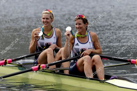 Victoria Thornley and Katherine Grainger, of Britain, hold their medals up after winning silver in the women's rowing double sculls final during the 2016 Summer Olympics in Rio de Janeiro, Brazil