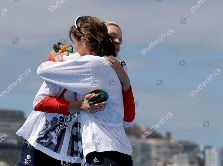 Victoria Thornley and Katherine Grainger, of Britain, embrace after winning silver in the women's rowing double sculls final during the 2016 Summer Olympics in Rio de Janeiro, Brazil