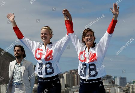 Victoria Thornley and Katherine Grainger, of Britain, react after winning silver in the women's rowing double sculls final during the 2016 Summer Olympics in Rio de Janeiro, Brazil